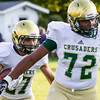 Record-Eagle/Brett A. Sommers Muskegon Catholic Central running back Dawson Fisher-Steigman (27) follows the blocking of tackle Jordan Porter (72) during Friday's game against Frankfort.