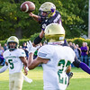 Record-Eagle/Brett A. Sommers Frankfort linebacker Griffin Kelly jumps to knock down a pass from Muskegon Catholic Central quarterback Cameron Martinez intended for Dawson Fisher-Steigman.