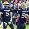 Record-Eagle/Brett A. Sommers Frankfort's Kirk Myers (5) celebrates with teammate Gabe Johnson after making a stop during Friday's game against Muskegon Catholic Central.