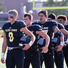 Record-Eagle/Brett A. Sommers Glen Lake's Drew Peterson (8) leads the Lakers lineup during the national anthem Thursday prior to hosting New Lothrop. New Lothrop won 48-16.