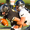 Record-Eagle/Brett A. Sommers Glen Lake' quarterback Joey Fosmore is sacked by New Lothrop's Harrett Birchmeier during Friday's football game. New Lothrop won 48-16.