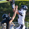 Record-Eagle/Brett A. Sommers New Lothrop's Dylan Shaydik (10) outjumps Glen Lake's JJ Bradford for a touchdown catch during Friday's football game. New Lothrop won 48-16.