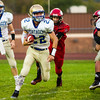 Record-Eagle/Brett A. Sommers Onekama running back Jacob Mauntler (22) runs the ball during Friday's football game. Onekama won 54-18.