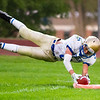 Record-Eagle/Brett A. Sommers Onekama's Ben Acton dives for the pylon on a run during Friday's game against Suttons Bay. He was ruled out of bounds. Onekama won 54-18.