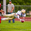 Record-Eagle/Brett A. Sommers Onekama's Ben Acton dives for the pylon on a run during Friday's game against Suttons Bay. Onekama won 54-18.
