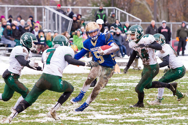 Record-Eagle/Brett A. Sommers Onekama running back Ben Acton (5) carries the ball as he is surrounded by four Portland St. Patrick defenders during Saturday's Division 2 8-player football semifinal in Onekama. Onekama won 28-14 to advance to the state championship game.