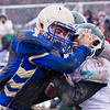 Record-Eagle/Brett A. Sommers Onekama quarterback Luke Mauntler (7) fights off a tackler on a run during Saturday's Division 2 8-player football semifinal in Onekama. Onekama won 28-14 to advance to the state championship game.