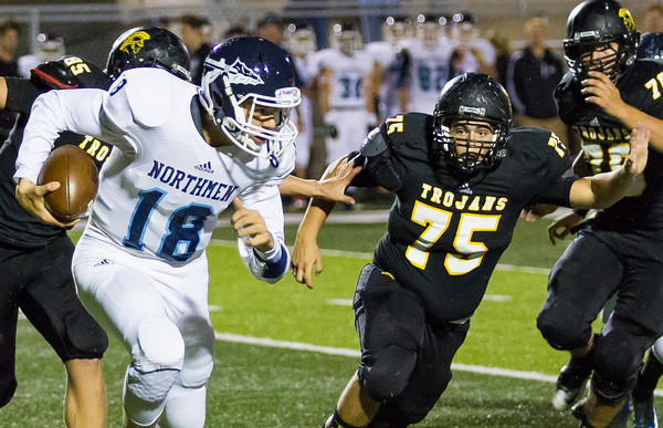 Record-Eagle/Brett A. Sommers Traverse City Central defensive lineman Wesley Greenman chases down Petoskey quarterback Joel Wilson during Friday's 49-20 win over Petoskey.