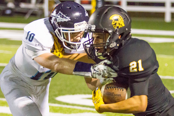 Record-Eagle/Brett A. Sommers Traverse City Central's Devante Walker stiff arms Petoskey's Jannsen Byers during Friday's 49-20 win over Petoskey.