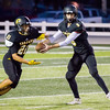 Record-Eagle/Brett A. Sommers Traverse City Central quarterback Tobin Schwannecke runs the read option with back Devante Walker during Friday's 49-20 win over Petoskey.