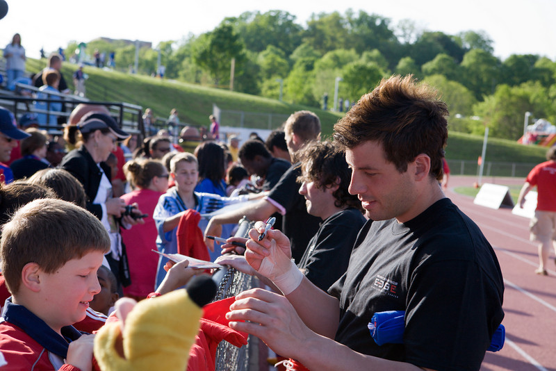 Brian Rowland signs autographs for the supporters.