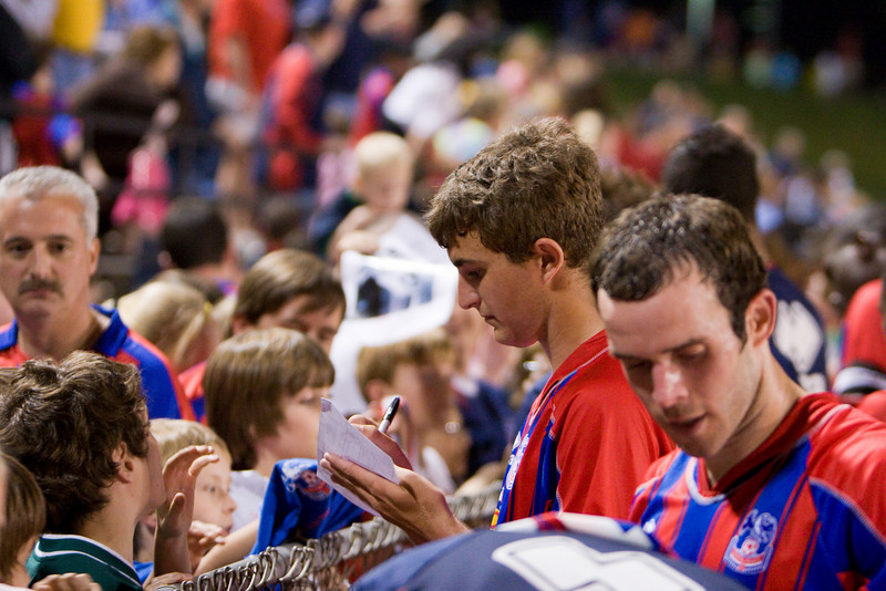 Pat Healey (center) and Paul Robson sign autographs for the fans.