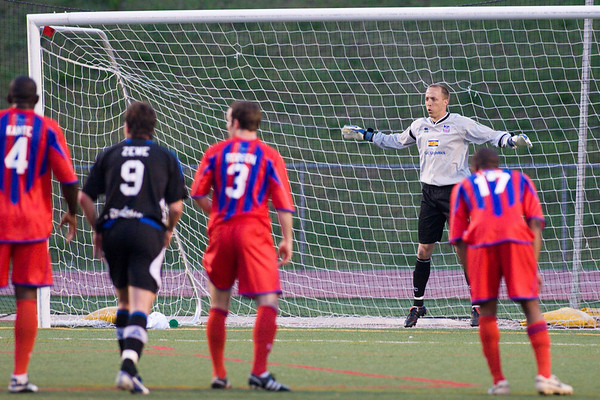 New Palace goalkeeper, Matt Nelson about to save Jean Robens Jerome's penalty kick.