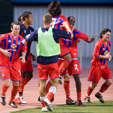 Alex Ughiovhe celebrates with the team after scoring Palace's second goal of the night.