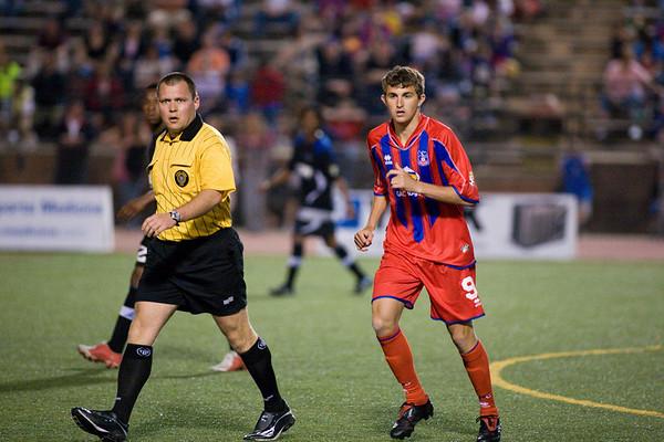 Referee Jeff Gontarek and Palace midfielder, Pat Healey.