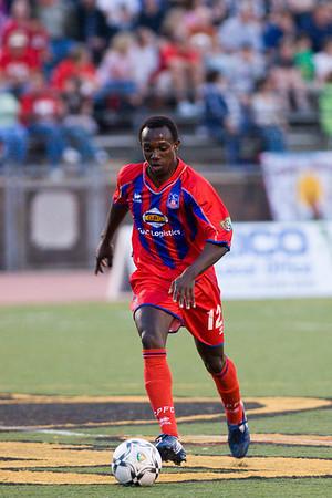Matthew Mbuta surges up the middle.