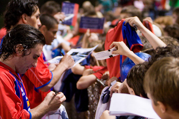 Bryan Harkin and other Palace players sign autographs for the supporters.