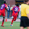 Gary Brooks turns to celebrate his opening goal on 8 minutes, chased by Alex Ughiovhe.