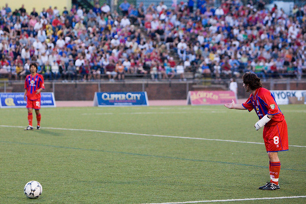 Bryan Harkin lines up a free kick.