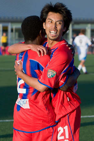 Shintaro Harada celebrates with Matthew Mbuta after Mbuta's goal.