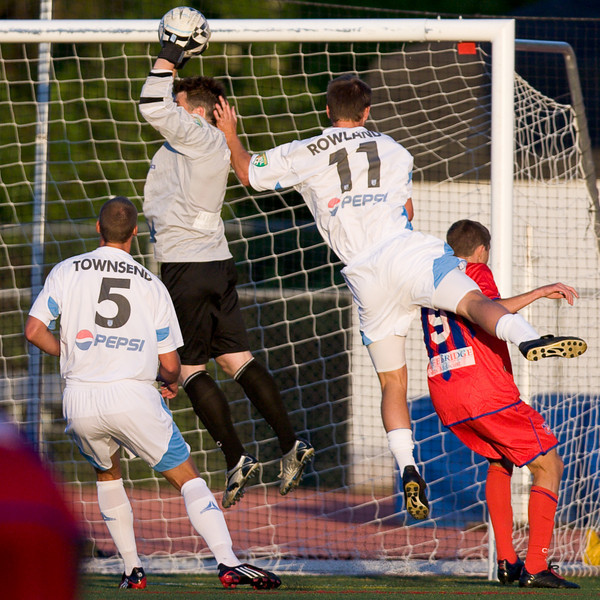 Brian Rowland rises high to gather the corner.
