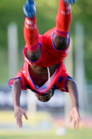Matthew Mbuta in mid-air during his trademark back-flip goal celebration.