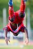 Matthew Mbuta in mid-air during his trademark back-flip goal celebration.