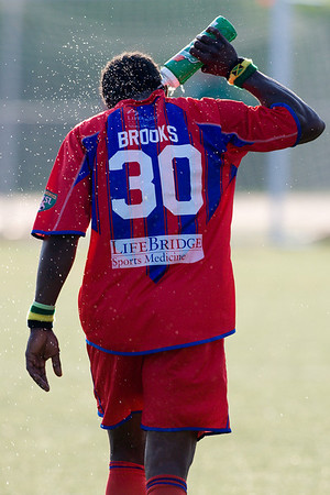 Gary Brooks keeps cool and hydrated in the 100+ degree temperatures