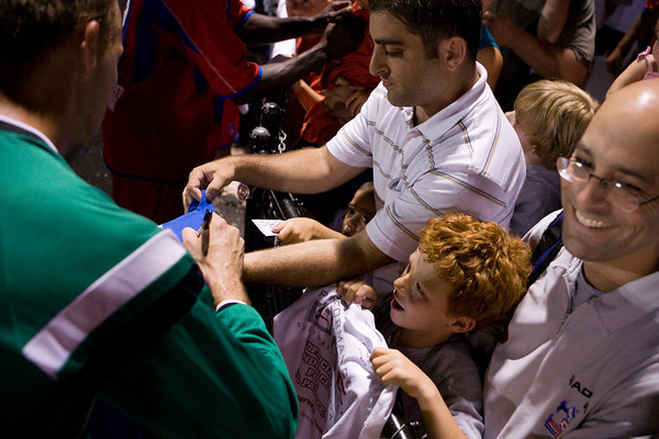A young fan makes sure he's getting all the players' autographs