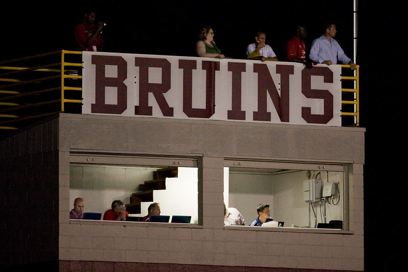 Pete Medd (far right) watches from atop the press box