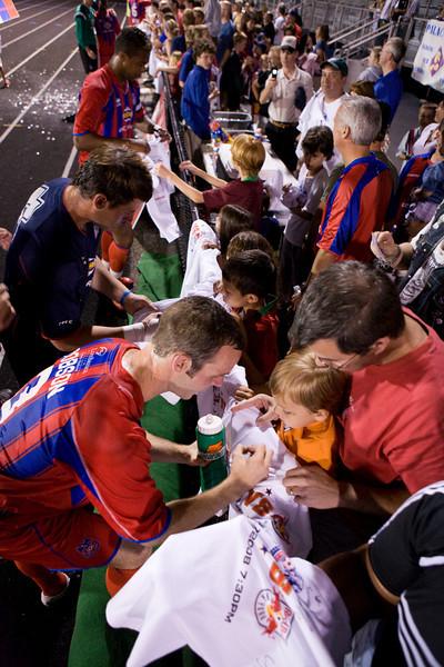 Paul Robson signs a shirt