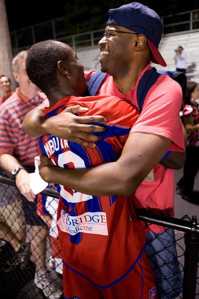 Matthew Mbuta celebrates with a supporter