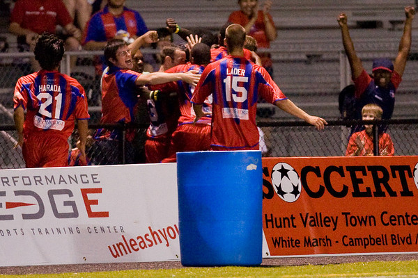 Gary Brooks runs over the crowd to celebrate scoring Palace's second goal