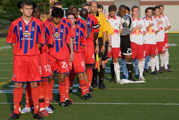 The teams line up for the national anthem