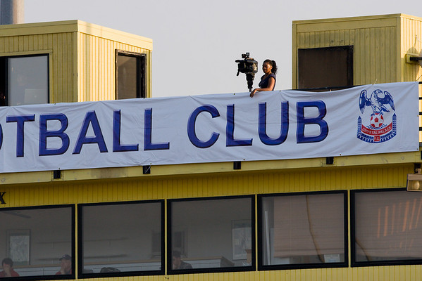 Channle 13 news videographer on roof of press box