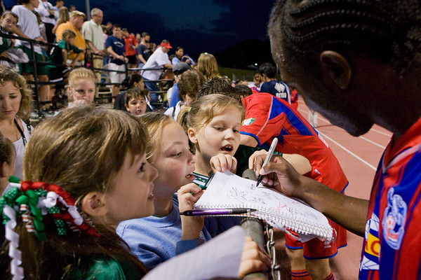 Kevin King signs the first of several pages for this enterprising young fan