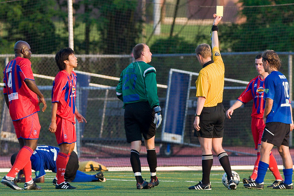 Matt Nelson is shown a yellow card for a foul outside the penalty box
