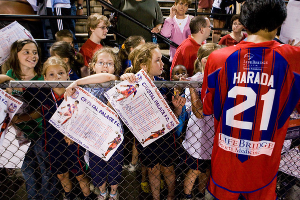 Young fans line up for Shintaro Harada to sign the schedule poster that bears his image