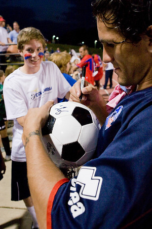 Sergio Flores signs a ball for a fan
