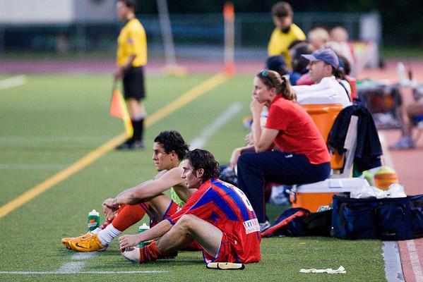 Flores, Harkin and Leslie Dawson looking despondent