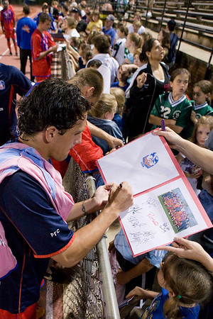 Sergio Flores signs a young fans home-made Palace autograph book