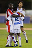 Ibrahim Kante and Shintaro Harada celebrate with goal-scorer Matthew Mbuta