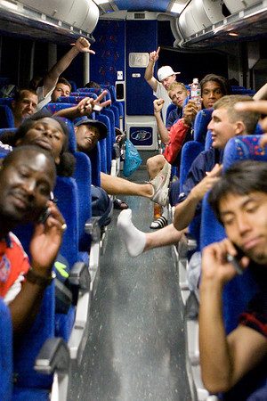 The team celebrates on the bus back to Baltimore