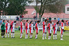 The starting eleven during the national anthem