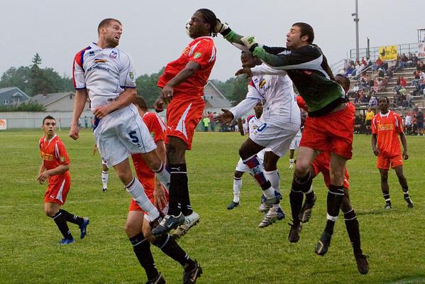 Andrew Marshall tries to head the ball beyond Pioneers' 'keeper Matt Glaeser