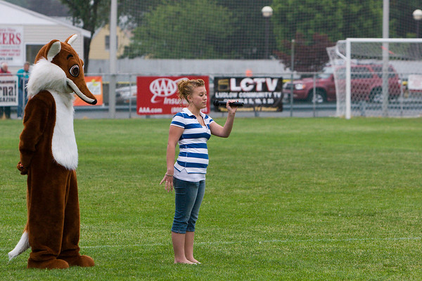 The national anthem singer, with Pioneers mascot Foxy