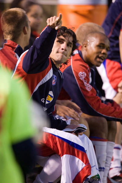 Sergio Flores and Larry Mark on the bench