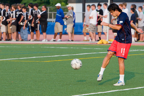 Sergio Flores warms up before the game while BBSL teams wait to receive their spring league awards