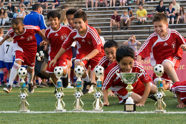 BBSL 1st and 2nd place teams are awarded their trophies on the pitch before the game