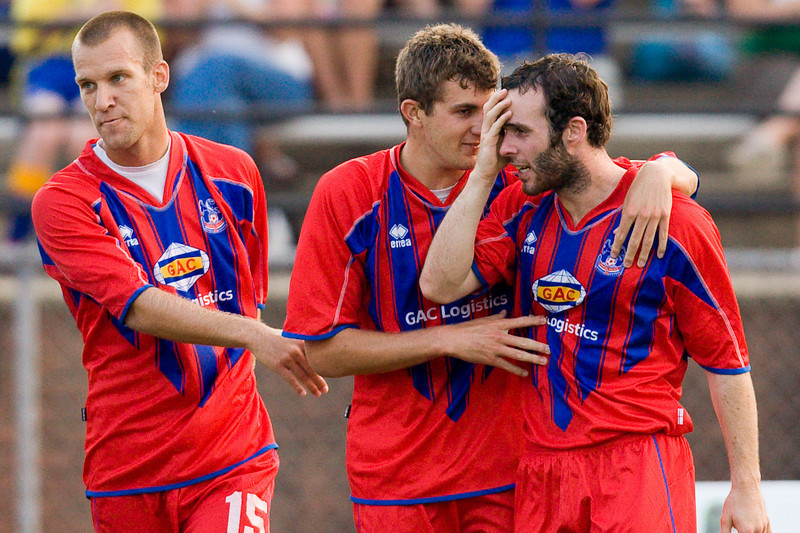 Paul Robson congratulated by Pat Healey who redirected Robson's shot for the goal